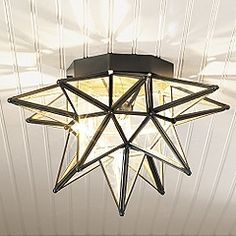 New home with comfortable charm pinterest moravian star light our moravian star lighting recreates that traditional form in clear glass and steel with hand applied bronze finish ceiling aloadofball Image collections