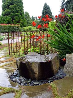 The Outdoor Fountains are an Interesting Idea in Beautifying Your Lovely Garden: Garden With Boulder And Entrance Also Entry Plus Flagstone With Outdoor Fountains And Lanterns Also Pavers With Pebbles And Permeable Paving Also Red Flowers Plus Rock With Rust And Water Feature Also Watsonia Plus  ~ idobrich.com Exterior Design Inspiration