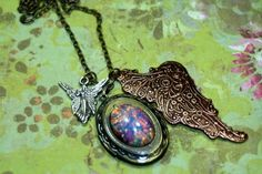 Fairytale Grotto Locket Charm Necklace Fire Opal Steampunk Wings Mixed | shadesongs - Jewelry on ArtFire