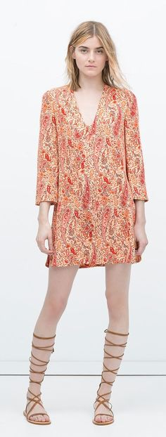 Bathing suit cover ups that will take you from beach to party all Summer long: Zara printed tunic with flared sleeves ($80)