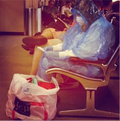 One passenger at Dulles International Airport outside Washington, D.C. is apparently not taking any chances. A female passenger dressed in a hazmat suit — complete with a full body gown, mask and gloves — was spotted Wednesday waiting for a flight at the airport. http://www.nuttynewstoday.com/2014/10/passenger-wears-a-hazmat-suit-to-dulles-airport/