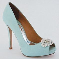 """he coveted tiffany blue shoe is back! The perfect """"something blue"""" shade for summer weddings. A fabulous party shoe for nights out on the town or a black tie affair as well. 4 1/2"""" heel, 3/4"""" covered platform, peep toe with decorative crystal ornament that is approx. 2 3/4"""" x 1 1/2"""". Designed by Badgley Mischka."""