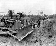 """American bulldozer, Caterpillar with a angledozer LeTourneau equipment and called """"booger kid"""" recorks holes bombs on a road of the Normandy countryside west of St. Caterpillar D4, Caterpillar Equipment, St Lo, Earth Moving Equipment, Normandy Beach, Us Armor, D Day Landings, Royal Engineers, Military Photos"""