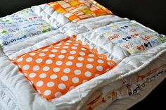 'Cheat' quilt :)  Simply sew squares of fabric onto a down comforter.  I have oodles of fabric squares cut from old baby clothes that I've been meaning to make into a quilt, but haven't.  This project is perfect for those with beginner sewing skills!  Kind of store bought and kind of homemade.
