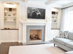 Fanily Room Cabinet Ideas. The family room built ins feature cherry counters and honed Blue Celeste marble fireplace. #FamilyRoom