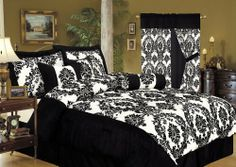 """7Pcs Queen Louisa Flocking Black Comforter Bedding Set by GreenCanyon. $69.99. This elegant woven flocking comforter set features floral velour design on silky ground. Comforter and shames have matching cording.3 decorative pillows are included. Features Color: Black Size: QueenMachine Washable Matching curtains availableThis set includes:1 Comforter (88""""x92"""")2 Shams (20""""x26"""")1 Bed Ruffle (60""""X80""""+14"""")1 Neckroll (9""""x15"""")1 Square Cushion(16""""x16"""")1 Rectangular Cush..."""