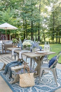 Charming!  Look at this beautiful, serene, outdoor entertainment area.  The wonderful center piece to the rustic chairs, fun!