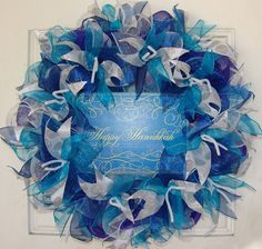 Looking for a lovely full and fluffy blue wreath to hang for Hanukkah? Leave it as is, or even add on your own embellishments to make it your own deluxe wreath! The different shades of blue really mak