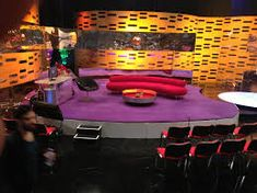 Tv studio  Note couch, interviewer seat, exit in the background
