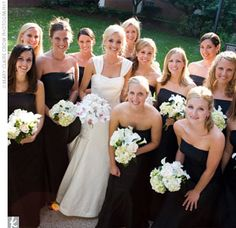 Lindsey's bridesmaids wore long, black, A-line dresses in silk dupioni by Watters and Watters; the dresses featured a tie in the back brought together in a knot.