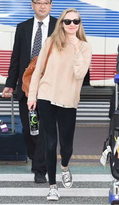 Amanda Seyfried looks totally adorable dressed down in leggings, a baggy sweater and Converse.