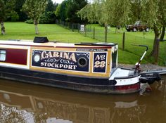 3D effect lettering with scumble paint effect and scrollwork. This photo has been taken from www.thefitoutpontoon.co.uk your resource and directory for canal boat buying, planning & building