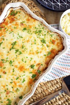 Easy to make completely from scratch, this Potatoes Au Gratin recipe is the best ever. Just like your favorite steakhouse but without leaving your kitchen. Perfect for any occasion. | @suburbansoapbox
