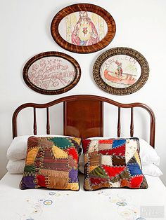 Head to your grandma's sewing room or flea market vendors specializing in vintage textiles to look for fabric and quilt remnants and needlework pieces that you can reuse to create pillows or frame as artwork. Stitched from sections of well-worn crazy quilts, these accent pillows captivate the eye and complement the stitchery displayed on the bedspread and the samplers showcased on the wall./