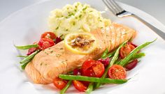 Baked Norwegian Salmon topped with an anchovy-lemon blend, served with tomatoes, green beans and olives.