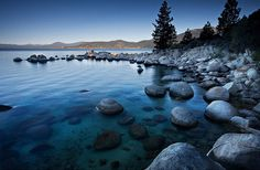 Beautiful Lake Tahoe lies in the Sierra Nevada mountain range along the border of California and Nevada in the United States. With 496 square kilometers (192 sq miles) of surface area and lovely mountain scenery, the lake is a major tourist destination year round.