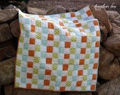 The Raggedy Basketweave Quilt is a creative quilt pattern that combines elements of rag quilting, quilt-as-you-go methods, and cheater quilt methods.