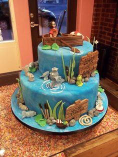 fishing cake, sugar row boat, fish, lures etc. www.acookieandacupcake.com
