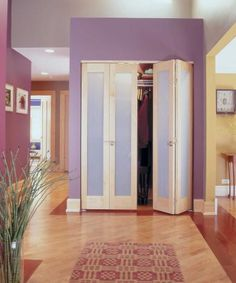 Mirrored closet doors with wood inlay   French F110 bi-fold doors in maple with prairie profile and white ...