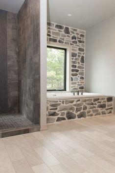 Flooring: Luxury Vinyl Tile, Adura, 6x18, Stucco ASP401; Shower: Tile, 18x18, Paramount Elements Bronze; Shower Accent: Tile, Basalt Blue Bamboo Honed Mosaic; Grout: Iron