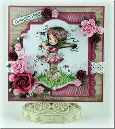 Bev Rochester: All the Things I Love Glitz Designs Pretty in Pink pad  Whimsy stamps: Sun Kissed (Elizabeth Bell). Copics/pencils:  Hair: E47, 44, 42, 40 and Warm Grey 90% pencil  Skin: E11, 00, 000, 0000. R20, 30  Apron: E41, E40 and Warm Grey 50% pencil  Jeans: E44, 42, 40 and Warm Grey 70% pencil  Top and flowers: R59, 56, 85, 83, 81, RV000, 0000 and Tuscan Red Pencil  Grass: YG63, 61, G20, G85 and Olive Green pencil  Shadow: Muted Turquoise pencil