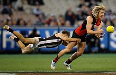 AFL 2014 Rd 17 - Essendon v Collingwood - Dyson Heppell of the Bombers is tackled by Josh Thomas of the Magpies during the 2014 AFL Round 17 match between the Essendon Bombers and the Collingwood Magpies at the MCG, Melbourne on July 13, 2014. (Photo: Michael Willson/AFL Media)