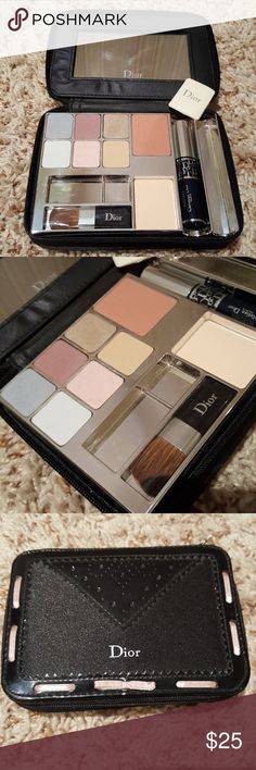 Dior Makeup Kit in Travel Case Dior Makeup Kit includes 6 eye shadow colors, 1 blush and 1 powder.  Comes with new blush brush and sponge.  this is perfect for on the go or travel.  It comes with this beautiful zipper case with mirror.  It's black with pink ribbon trim.  I only used the shadows a couple of times so it's in Excellent condition.  The mascara is dried out but I can include it as part of the set for the packaging. Dior Makeup Eyeshadow