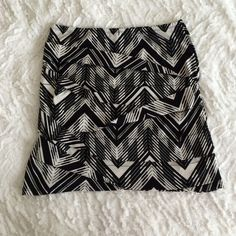 Black and white patterned mini skirt This is a black and white patterned mini skirt from Forever 21. Has been worn so there's some wear on it but in pretty good condition. Has a fun texture to it too! Forever 21 Skirts Mini