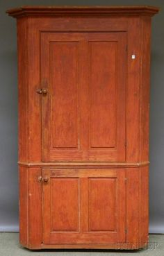 Red-painted Wood Corner Cupboard with Two Paneled Doors, the upper cabinet with two fixed shelves, ht. 77, wd. 47, dp. 25 in.