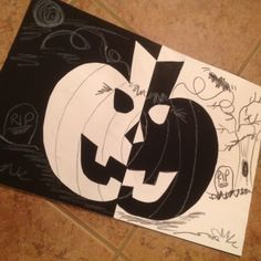 A Jack o' Lantern is made from black and white construction papers and decorated to reinforce SYMMETRY