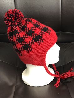 290e61f0626 Earflap hat knitted in fair isle buffalo plaid. Click ""