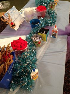 Frozen Christmas Party:  Activity booth for reindeer ornaments.