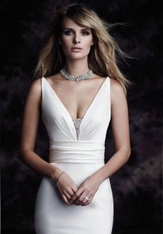 Paloma Blanca mermaid styled gown with plunging V-neckline and beaded embellishments I Style: 4603 I https://www.theknot.com/fashion/4603-paloma-blanca-wedding-dress?utm_source=pinterest.com&utm_medium=social&utm_content=june2016&utm_campaign=beauty-fashion&utm_simplereach=?sr_share=pinterest