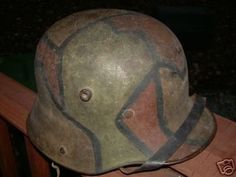 Up for auction is this stunning World War I camouflage German Helmet. As you can see, this is an early M16 with the leather liner band. This is a guaranteed original camouflage and I believe the pict