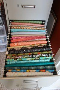 Use a File Cabinet + Hanging File Folders for storing and organizing fabric.