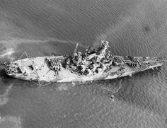 USS Indiana off Norfolk, Virginia, United States, 8 Sep 1942, photo 1 of 5; note No. 1 and No. 3 turrets turned to starboard