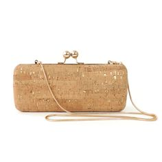 """Happy Holidays from Spicer Bags!  The Evening Clutch is the perfect bag to bring to the holiday parties! The collection features sophisticated, sleek styles in our unique cork and stone materials. Each Evening Clutch is made by hand in our San Francisco studio, where our signature textiles are wrapped around high quality metal frames. The clutches feature a 37"""" tuck-away removable chain and black satin lining. They can fit your necessities for an evening out."""