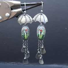 So freaking cool.  Sterling Silver and Painted Fused Glass Earrings by xaosart.