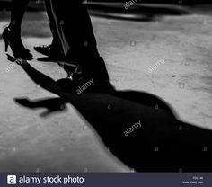 Detail of shoes with shadows in milonga ballroom Stock Photo, Royalty Free Image: 94306694 - Alamy