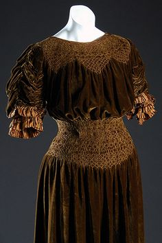 circa 1910 Liberty of London Dress, silk velvet, England. Designed to meet standards of comfort and beauty, this dress' smocked  yoke and waist ensure a comfortable fit.