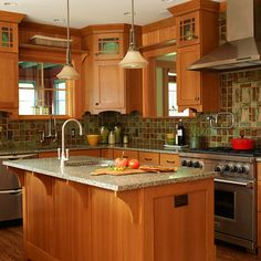 Loving the earth tones! The cabinetry design is very nice. Cherry wood is my favorite...I can picture myself right there at that center island, prepping for a lovely dinner:)