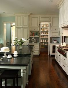 Like all the contrasts in floor counter tops and cabinets