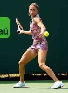 Camila Giorgi Photos - Camila Giorgi of Italy returns a shot to Simona Halep of Romania during day 7 of the Miami Open Presented by Itau at Crandon Park Tennis Center on March 2015 in Key Biscayne, Florida. Camila Giorgi, Tennis Stars, Crandon Park, Tennis World, Tennis Players Female, Beautiful Athletes, Tennis Fashion, Sport Tennis, Sporty Girls