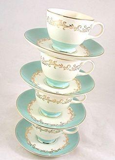 white, aqua and gold teacups