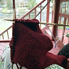 It is so refreshing to be out on the deck again! I'm knitting while the kids are shooting their bows made out of little sticks. Springtime is the best.