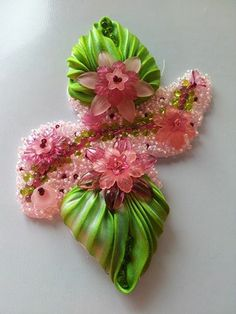 Pin only uploaded by pinner. Beautiful shibori leaves with bead work.