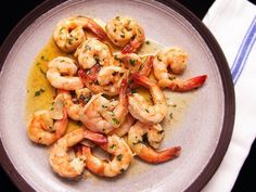 Juicy, tender shrimp packed with layered garlic flavor and plenty of olive oil makes the perfect Spanish-style snack. Spanish-Style Garlic Shrimp (Gambas al Ajillo) - Serious Eats Shrimp Dishes, Shrimp Recipes, Food Network, Food Porn, Avocado Salat, Food Lab, Garlic Shrimp, Cooked Shrimp, Garlic Sauce