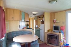 Shaldon Caravan - for 4 to 6 people Bronze, 2 bedroom caravan, with 1 double and 1 twin room + double sofa bed in lounge. Devon Holidays, Twin Room, Holiday Accommodation, Sofa Bed, Caravan, Corner Desk, Lounge, Bronze, Homes