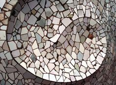 https://flic.kr/p/6nexWx | Gaudi Mosaic | The decoration on the side of one of the staircase tops on the roof terrace of La Pedrera.  Casa Mila, popularly known as La Pedrera (The Stone Quarry), is a spectacular apartment block designed by Antoni Gaudi in the Eixample area of Barcelona.  It was commissioned by industrialist Pere Mila and was built between 1906 and 1912 on the Passeig de Gracia, one of the main roads in the city.  The apartment block was Gaudi's last civil work before he…