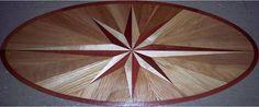 "36"" wide by 72"" long oval Siyokoy hardwood floor medallion inlay.  Red Oak, Curly White Maple, Massarunduba"